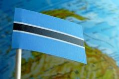 Флаг Ботсваны с картой глобуса как предпосылка Стоковое Изображение