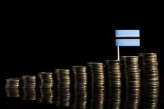 Флаг Ботсваны с серией монеток изолированных на черноте Стоковое Изображение RF