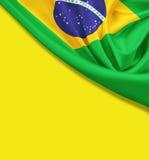 Флаг Бразилии на желтой предпосылке стоковые фотографии rf