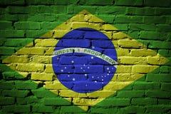 Флаг Бразилии покрашенный на кирпичной стене Стоковое Изображение