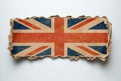 Флаг британцев на сорванном картоне стоковые изображения rf