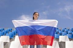 Флаг вентилятора спорт девушки развевая Стоковое Фото