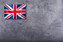Флаг Великобритании Великобританский флаг Юниона Джек на конкретной предпосылке Стоковые Изображения RF
