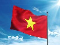 Флаг Вьетнама развевая в голубом небе Стоковое фото RF