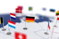 Флаг Германии в фокусе Карта Европы с флагами стран Стоковые Фото