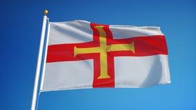 Флаг Гернси в замедленном движении плавно закрепил петлей с альфой видеоматериал