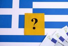 Флаг Греции с банкнотами вопросительного знака и евро Стоковая Фотография RF