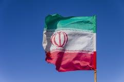 Флаг Ирана развевая в ветре Стоковое Изображение