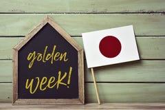 Флаг недели и японца текста золотой Стоковые Изображения RF