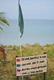 Флаг пляжа на Pantai Cenang Стоковая Фотография
