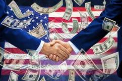 Флаг рукопожатия денег американский стоковые изображения rf