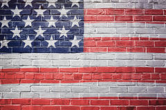 Флаг США покрашенный на кирпичной стене 4-ая предпосылка июль Стоковая Фотография