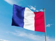 Флаг француза развевая в голубом небе Стоковая Фотография RF