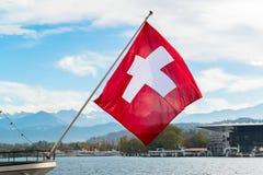 Флаг Швейцарии развевая Стоковое Изображение RF