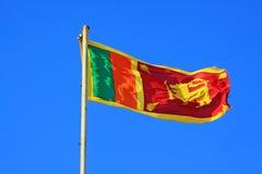 Флаг Шри-Ланки порхая стоковое изображение