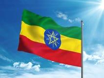 Флаг Эфиопии развевая в голубом небе Стоковые Изображения