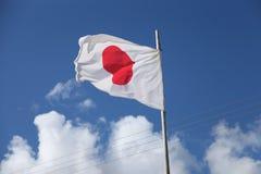 Флаг Японии, голубое небо, ветер Стоковая Фотография RF
