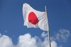 Флаг Японии, голубое небо Стоковые Фотографии RF