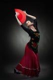 Фламенко танцев молодой женщины на черноте Стоковое Изображение RF