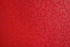 Флористический орнамент на красной таблице Стоковая Фотография