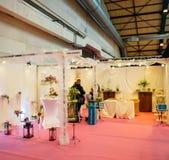 Флорист на экспо свадьбы Стоковая Фотография RF