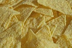 Хаотично штабелированные Nachos предпосылки еды, стоковое фото rf