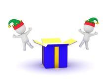 характеры 3D с шляпами эльфа и открытой подарочной коробкой Стоковая Фотография