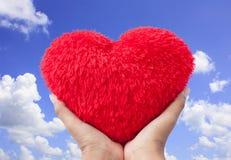 Харт красного цвета владением руки Стоковое Изображение RF