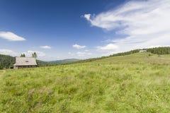Хата в гористой местности Стоковая Фотография RF