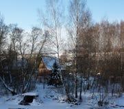 Хата в лесе зимы Стоковое Изображение RF