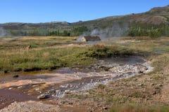 Хата и горячие источники в Исландии Стоковая Фотография RF
