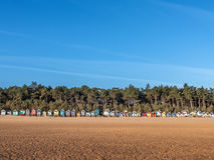 Хаты пляжа на восходе солнца Стоковые Изображения