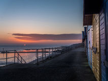 Хаты пляжа на зоре Стоковые Фотографии RF