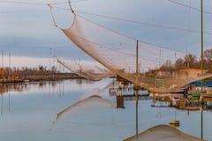 Хаты рыбной ловли на лагуне морской воды Стоковые Изображения