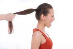 Хватать волосы. стоковые фотографии rf