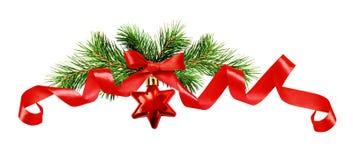 Хворостины рождественской елки, красная звезда и лента шелка обхватывают Стоковые Фотографии RF