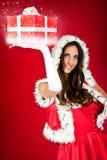 хелпер держа присутствующий s santa sparkly Стоковые Изображения