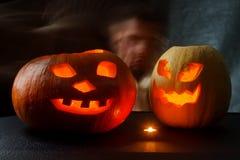Хеллоуин - Джек-o-фонарик тыквы на черной предпосылке Стоковые Изображения