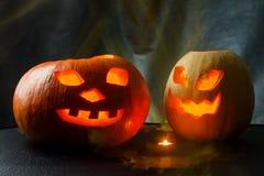 Хеллоуин - Джек-o-фонарик тыквы на черной предпосылке Стоковое Фото