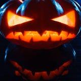 Хеллоуин - ужасная тыква на черной предпосылке Стоковое Фото