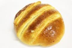 Хлеб крупного плана на белой предпосылке стоковое фото