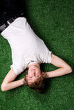 хлопец травы Стоковые Изображения