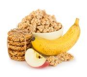 Хлопья для завтрака с концом-вверх банана и яблока на белой предпосылке Стоковое Изображение