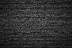 Хмурая предпосылка, черная кирпичная стена темной каменной текстуры Стоковое Фото