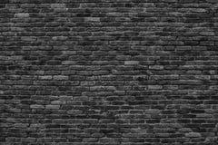 Хмурая предпосылка, черная кирпичная стена темной каменной текстуры Стоковая Фотография