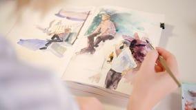 Хобби таланта художника sketchbook картины акварели видеоматериал
