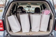 Хобот заполненный с хозяйственными сумками стоковое фото rf