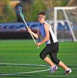 ход игрока lacrosse девушки Стоковая Фотография RF