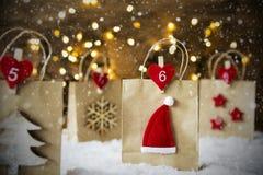 Хозяйственная сумка рождества, снежинки, шляпа Санты, звезды Стоковое фото RF