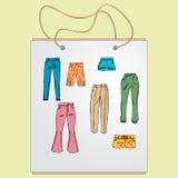 Хозяйственная сумка, сумка подарка с изображением модных вещей Стоковые Фото